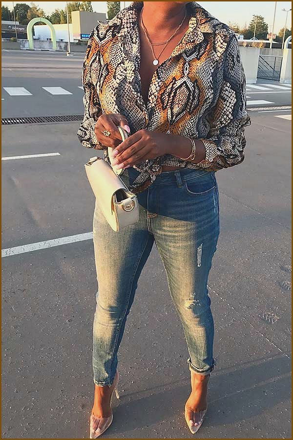 Animal Print Blouse with Jeans Outfit Idea